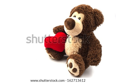 Teddy Bear with red heart - stock photo