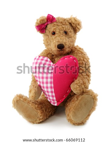 Teddy bear with red heart isolated on white background