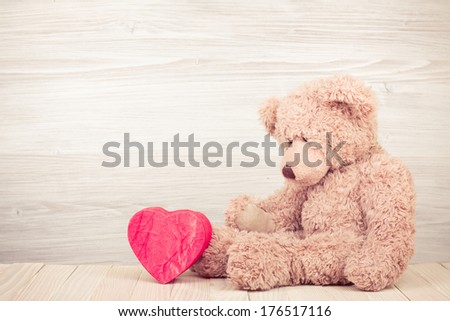 Teddy Bear with red heart shaped box - stock photo