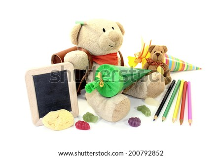 Teddy bear with school bag, wallet and table on a light background - stock photo