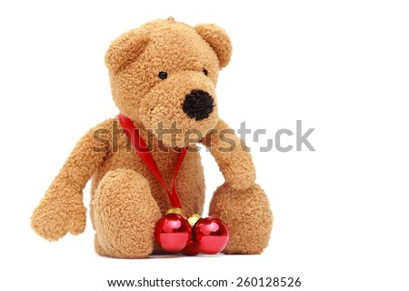 Teddy bear with small red decorative balls on Christmas - stock photo