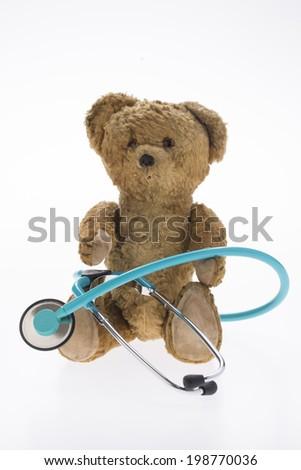teddy bear with stethoscope - stock photo