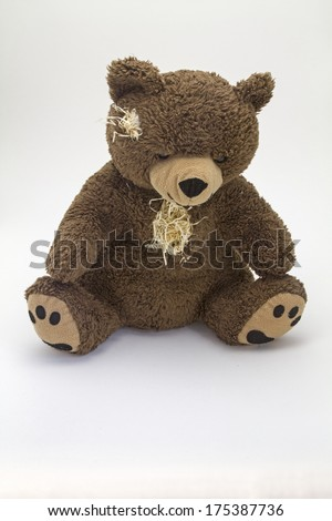 Teddy bear, worn and old - loyal and indispensable companion of many children - stock photo