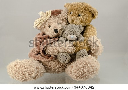 Teddy Bears fall and wander. Mr. and Mrs. bear with the child.  - stock photo