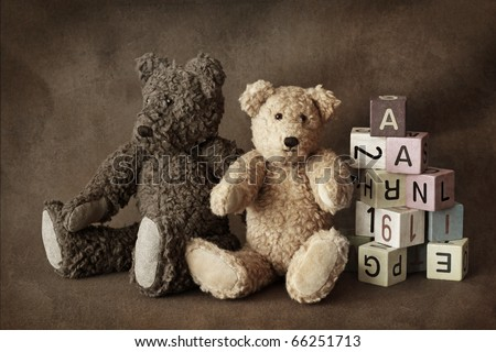 Teddy bears on brown background - stock photo