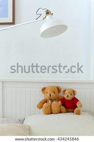 Teddy bears sitting in the white bedroom with love. Concept about love and relationship - stock photo