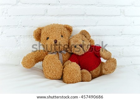 Teddy bears sitting in the white bedroom with love. Concept about love and relationship