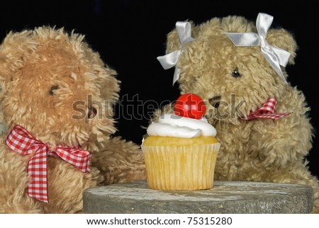 teddy bears with cupcake - stock photo