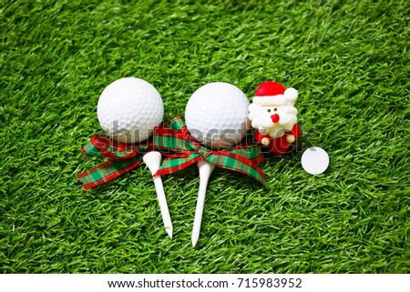Tee and golf ball and Santa are on green course