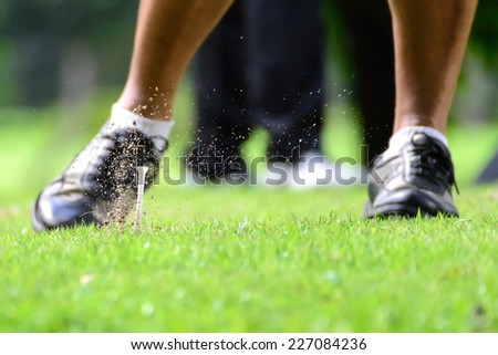 Tee on air after swing driving - stock photo