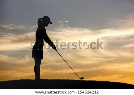 Teeing up at sunset. - stock photo