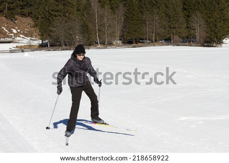 Teen age boy enjoying cross country skiing in Alp's valley - stock photo
