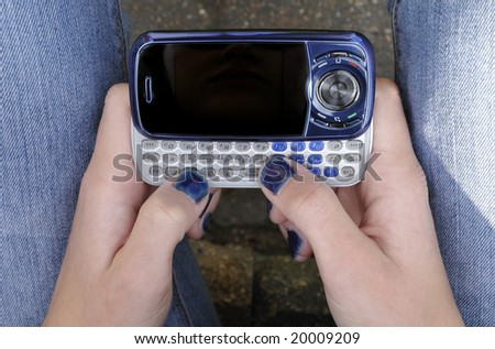 teen aged girl preparing to text message - stock photo