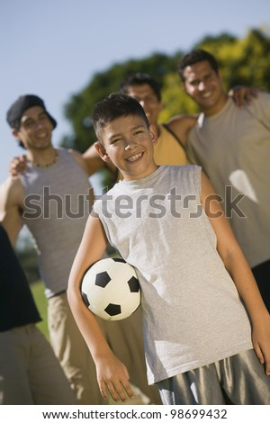 Teen at Park with His Family - stock photo