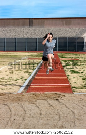 Teen athlete during her triple jump practice