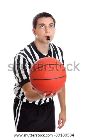 Teen basketball referee about to toss the ball in the air isolated on white