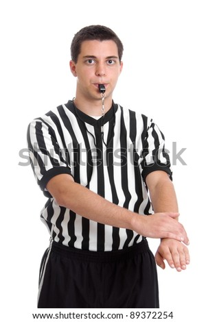 Teen basketball referee giving sign for defensive foul - stock photo