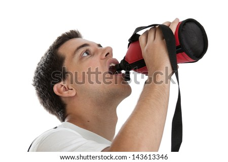 Teen boy drinking from a water bottle isolated on white background - stock photo