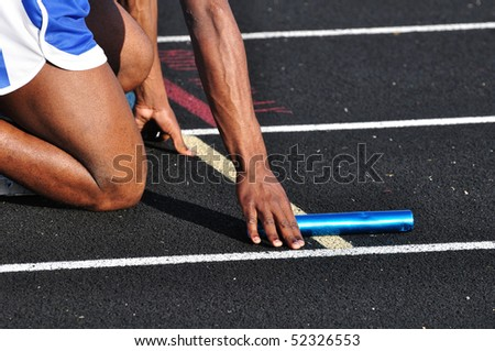 Teen Boy in the Starting Blocks at a Track Meet - stock photo