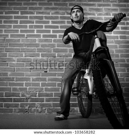 teen boy on bmx bicycle - stock photo