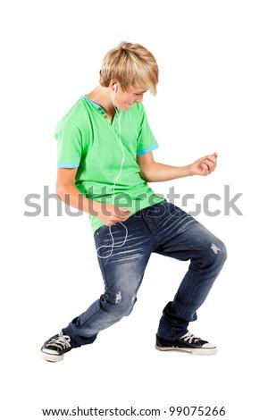 teen boy playing air guitar - stock photo