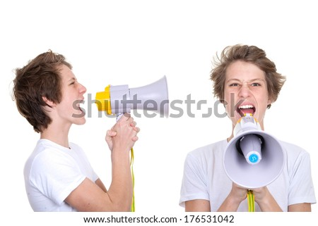teen boy shouting into megaphone.