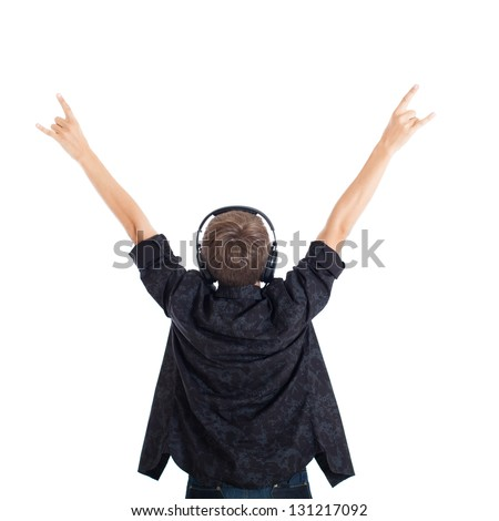 Teen boy wearing a black shirt with headphones. The boy raised his hands. Rock fan. View from the back. Studio shot, isolated on white background. - stock photo