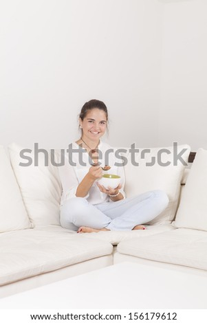 Teen breakfast cereal in a white couch - stock photo