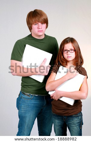 teen brother and young sister holding white notebooks