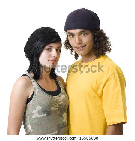 Teen couple against white background - stock photo