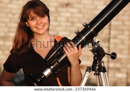 Teen girl and telescope. Near Kiev,Ukraine - stock photo