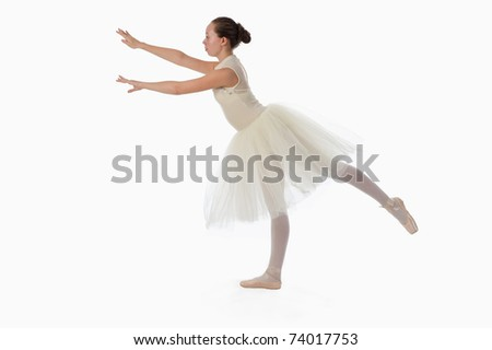 teen girl ballet dancer standing in a tutu in points on a white background - stock photo