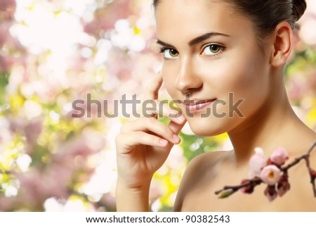 teen girl beautiful cheerful enjoying over spring Japanese cherry tree background - stock photo