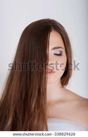 teen girl cheerful enjoying beauty portrait with beautiful bright brown long hair isolated  background - stock photo