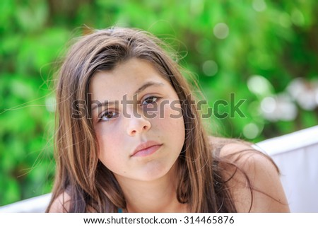 teen girl cheerful enjoying beauty portrait with beautiful bright brown long hair isolated over green background - stock photo