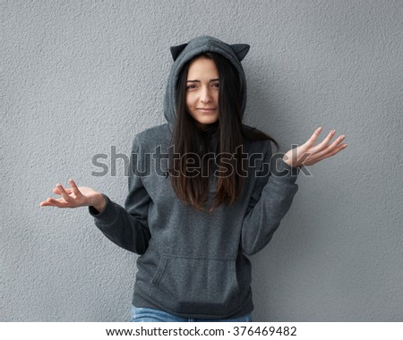 Teen girl does not understand what happened - stock photo