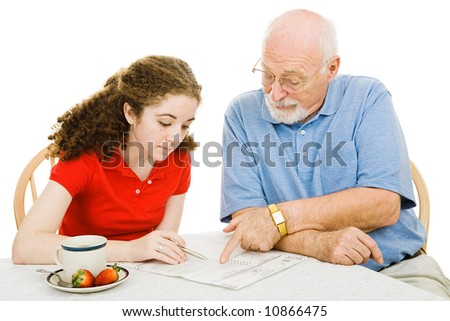 Teen girl filling out absentee ballot gets help from her grandfather.  Isolated on white. - stock photo