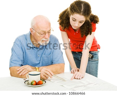 Teen girl helping her grandfather read the fine print on his absentee ballot.  Isolated on white. - stock photo