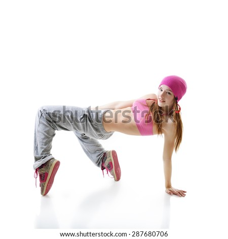 Teen girl hip-hop dancer over white background - stock photo