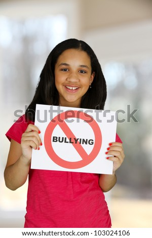 Teen girl holding a card that says no bullying - stock photo