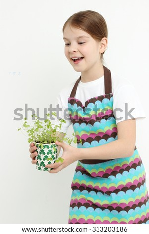 Teen girl holding parsley