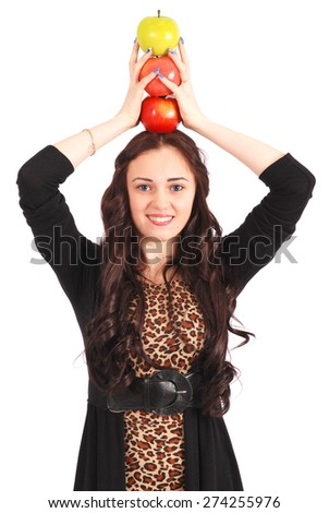 Teen girl holds an three apples on her head isolated on white - stock photo