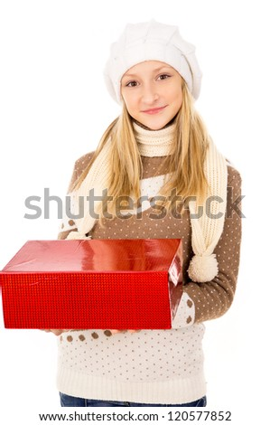 Teen girl in a hat holding a gift - stock photo