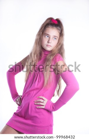 teen girl in a pink dress posing in studio, isolated image