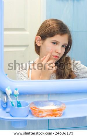Teen girl in bathroom - stock photo