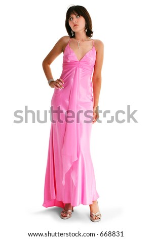 Teen Girl In Pink Formal Dress. Shot in studio over white.