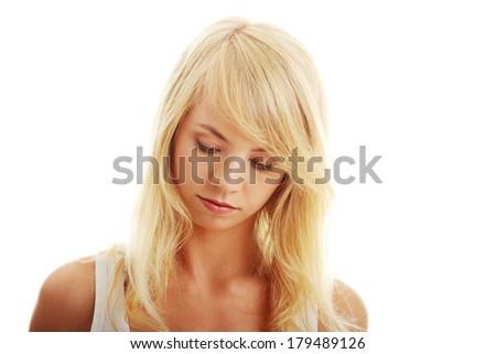 Teen girl looking below, isoalated on white background  - stock photo