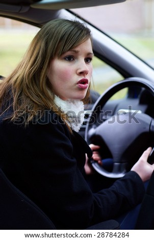 Teen girl mad behind the wheel. - stock photo