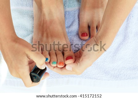 Teen girl makes a pedicure for the first time.