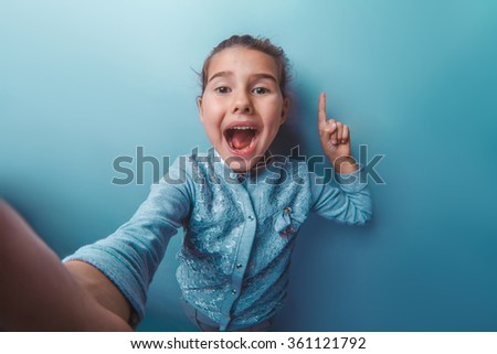 teen girl of European appearance seven open her mouth idea years - stock photo